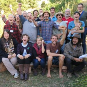Permaculture course participants smiling and laughing